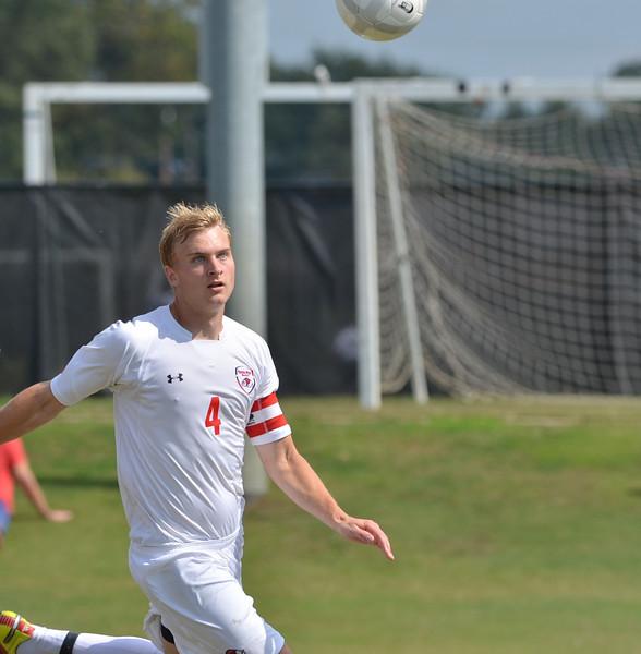 Jon Ole Reinhardsen (4) focus' on the ball.