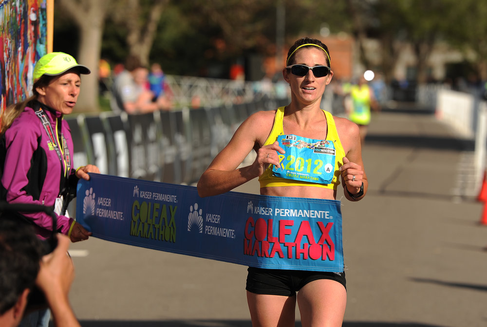 . Lori Walker, of Henderson, CO, is the first woman to finish the Colfax Half Marathon.  She won it in a time of 1:20:02.  The Colfax Marathon, the Half Marathon and the Urban Ten-Miler were held in City Park in Denver, CO on May 19th, 2013. The popular running events, sponsored by Kaiser Permanente, were sold out and thousands of runners took part in all three races.  Temperatures were cool with cloudy skies making for record setting times on both the marathon and the half marathon by the winners.  (Photo by Helen H. Richardson/The Denver Post)