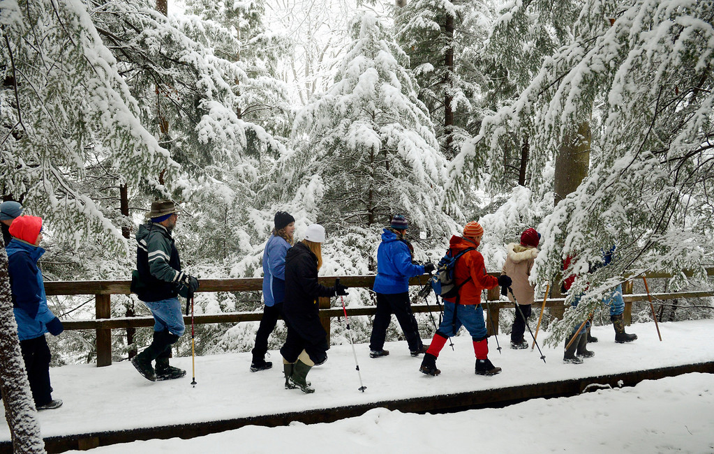 . Maribeth Joeright/MJoeright@News-Herald.com A hardy group hikes through a forest of hemlock trees at Lake Metroparks Penitentiary Glen.