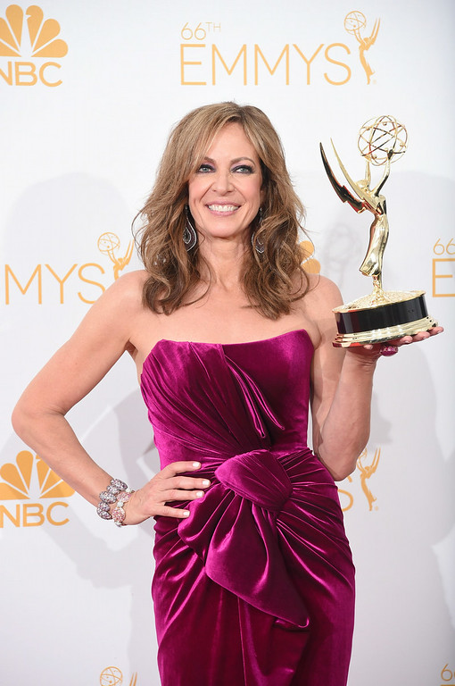 ". Actress Allison Janney, winner of the Outstanding Supporting Actress in a Comedy Series Award for ""Mom\"" poses in the press room during the 66th Annual Primetime Emmy Awards held at Nokia Theatre L.A. Live on August 25, 2014 in Los Angeles, California.  (Photo by Jason Merritt/Getty Images)"