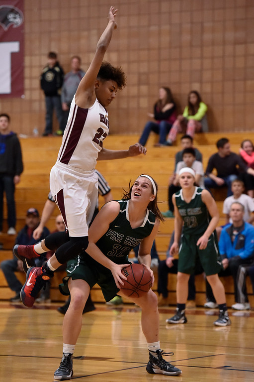 . THORNTON, CO - MARCH 01: Horizon Isabella Allen (23) goes up hi to block a shot by Pine Creek Emma List (32) during the Girls Class 5A Sweet 16 game March 1, 2016 at Horizon HS. (Photo By John Leyba/The Denver Post)