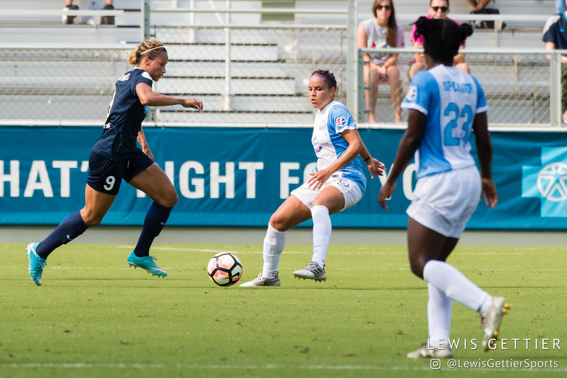Jaelene Hinkle (15) and Monica Hickmann Alves (21) during a match between the NC Courage and the Orlando Pride in Cary, NC in Week 3 of the 2017 NWSL season. Photo by Lewis Gettier.