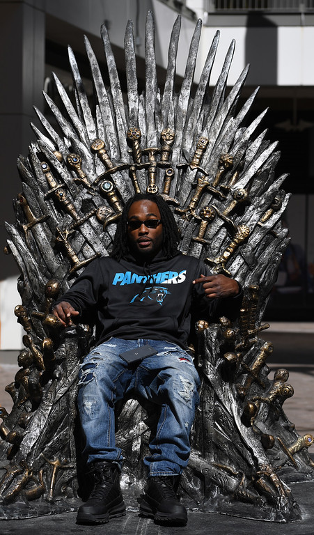 """. DENVER, CO - APRIL 22: Carolina Panther\'s fan Donald Cobb, from Middletown, Del. The famous seat that characters are battling for in HBO\'s smash hit \""""Game of Thrones\"""" is now on display in the Denver Pavilions in downtown Denver for fans to pose and take pictures with for free leading up to the premiere of the show\'s sixth season on Sunday. (Photo by Kathryn Scott Osler/The Denver Post)"""