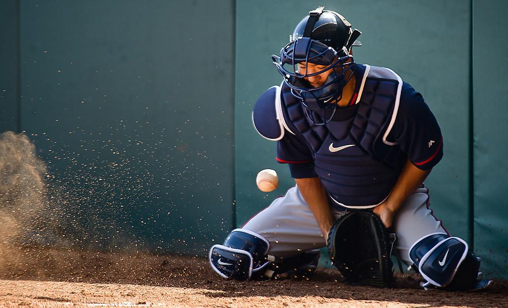 . Catcher Kurt Suzuki blocks a pitch in the dirt during a bullpen session. (Pioneer Press: Ben Garvin)