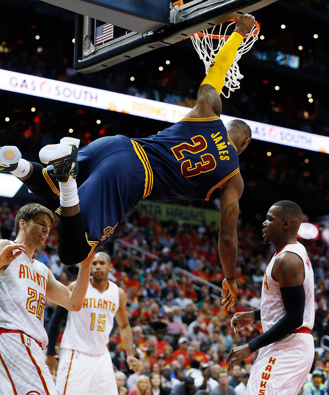 . Cleveland Cavaliers forward LeBron James (23) hangs from the rim after dunking the ball against the Atlanta Hawks in the second half of Game 3 of the second-round NBA basketball playoff series, Friday, May 6, 2016, in Atlanta. The Cleveland Cavaliers won 121-108. (AP Photo/John Bazemore)