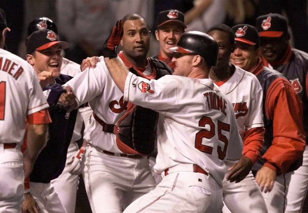 . Cleveland Indians\' Jim Thome (25) celebrates with his teammates after hitting the game-winning, two-run home run off Anaheim Angels pitcher Troy Percival in the ninth inning Friday, Aug. 4, 2000, in Cleveland. The Indians won 11-10. (AP Photo/Tony Dejak)