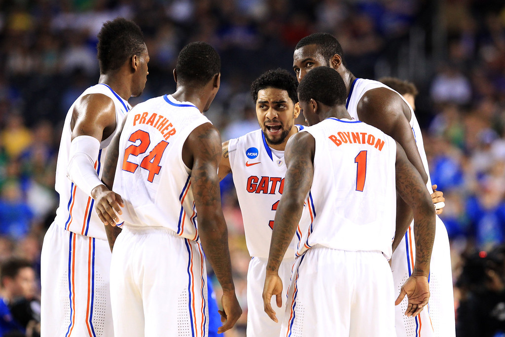 . ARLINGTON, TX - MARCH 29:  Mike Rosario #3 of the Florida Gators huddles with teammates in the first half against the Florida Gulf Coast Eagles during the South Regional Semifinal round of the 2013 NCAA Men\'s Basketball Tournament at Dallas Cowboys Stadium on March 29, 2013 in Arlington, Texas.  (Photo by Ronald Martinez/Getty Images)