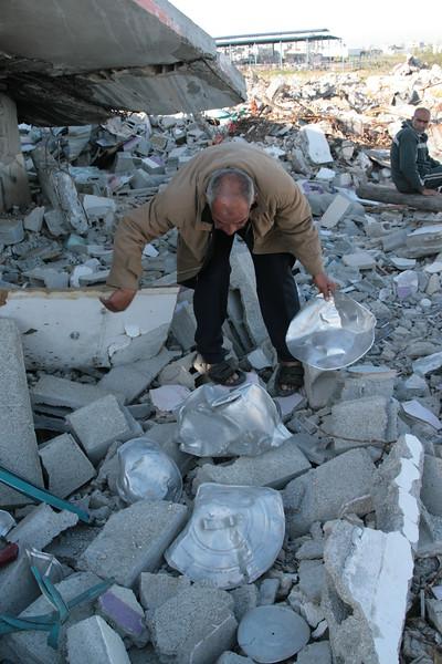 Man at the ruin of his house in Jabaliya camp