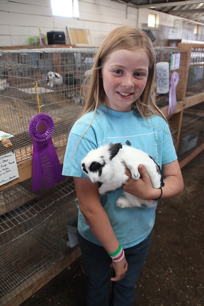 Havre Daily News / Floyd Brandt   4H / FFA Rabbit Showing Blain County Fair Saturday, Aisslian Handy with her rabbit Oreo over all Grand Champion