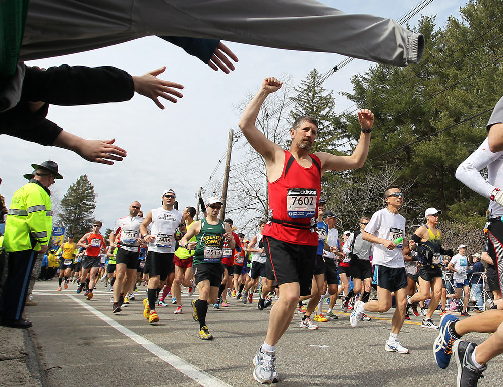 . Chris Royer, from Coventry, Vt., raises his hands as he starts of the 117th running of the Boston Marathon, in Hopkinton, Mass., Monday, April 15, 2013. (AP Photo/Stew Milne)