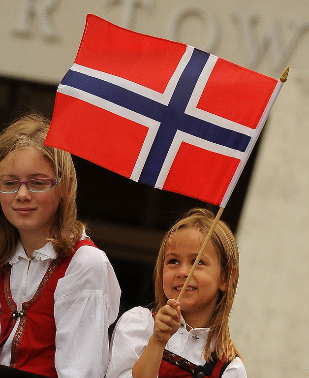 . Brita Amine Hendrickson, 7, waves a Norwegian flag during the Sons of Norway\'s Celebration of Norway\'s Constitution Day in downtown San Bernardino May 17, 2013.  (Photo by Gabriel Luis Acosta/The Sun)