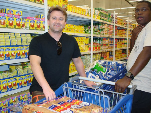 Buying tons of food to bring to Port-au-Prince.