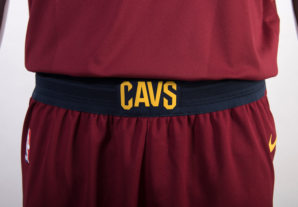 . The wine Icon edition uniform features CLEVELAND across the chest in gold accented by a navy outline. The front and back player numbers are navy with a gold outline. The trim on the collar and shoulders of the jersey is navy, while the lettering (last name) on the back of the jersey is gold. The navy waistband on the shorts showcases the word �CAVS� front and center.  (Courtesy Cleveland Cavaliers)