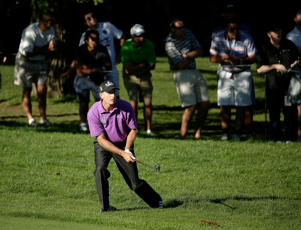 . Jim Furyk watches his shot out of the rough on the 16th hole during the third round of the PGA Championship golf tournament at Oak Hill Country Club, Saturday, Aug. 10, 2013, in Pittsford, N.Y. (AP Photo/Charlie Riedel)