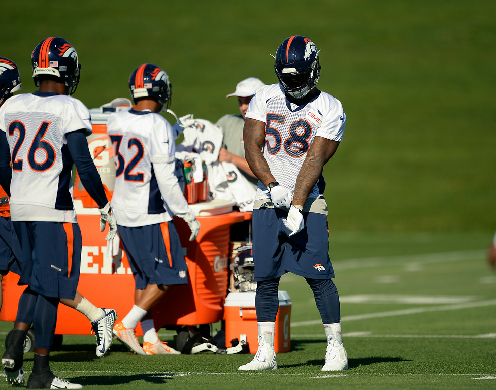 . Denver Broncos outside linebacker Von Miller (58) pus on his gloves during the start of the Denver Broncos 2014 training camp July 24, 2014 at Dove Valley. (Photo by John Leyba/The Denver Post)