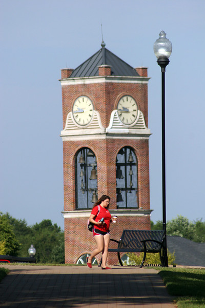 Gardner-Webb Student walking to class on a September morning in from of the bell tower.