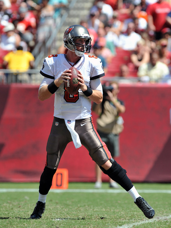 . TAMPA, FL - SEPTEMBER 29:  Quarterback Mike Glennon #8 of the Tampa Bay Buccaneers looks to pass against the Arizona Cardinals  September 29, 2013 at Raymond James Stadium in Tampa, Florida. (Photo by Al Messerschmidt/Getty Images)