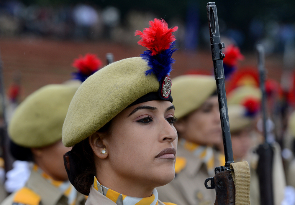 ". Jammu and Kashmir Armed Police (JKAP) servicewomen stand in formation during celebrations marking India\'s Independence Day at The Bakshi Stadium in Srinagar on August 15, 2013. Premier Manmohan Singh warned Pakistan August 15 against using its soil for ""anti-India activity\"", following a fresh escalation of tensions between the nuclear-armed neighbours over a deadly attack on Indian soldiers. MUSTAFA/AFP/Getty Images"