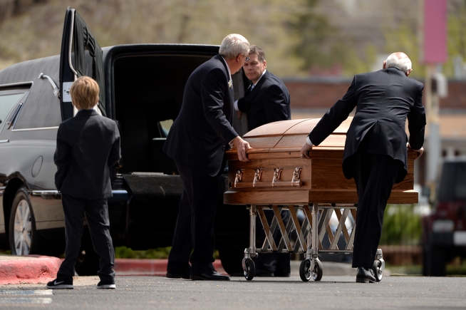 . Casket of Kristine Kirk is leaving  Most Precious Blood Catholic Church. Kirk, allegedly killed by her husband while she called 911, is memorialized at funeral mass. Denver, Colorado. April 25. 2014. (Photo by Hyoung Chang/The Denver Post)