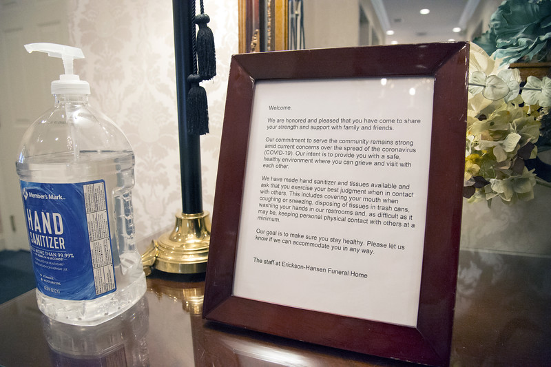 edcc03/19/20   Wesley Bunnell | Staff  A sign inside of Erickson-Hansen Funeral Home located at 411 S. Main St in New Britain warning people to use precautions.