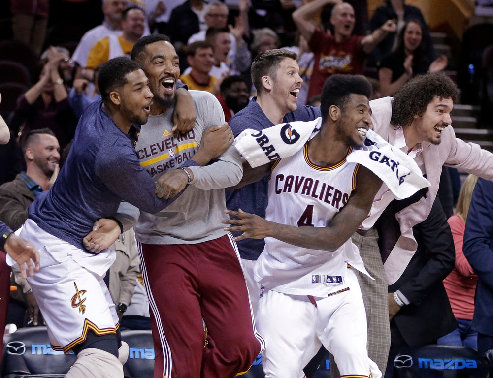 . Cleveland Cavaliers\' Tristan Thompson, left, J.R. Smith, second form left, Mike Miller, third from left, Iman Shumpert (4) and Anderson Varejao, right, celebrate after a 113-108 win in overtime over the Washington Wizards in an NBA basketball game Wednesday, April 15, 2015, in Cleveland. (AP Photo/Mark Duncan)