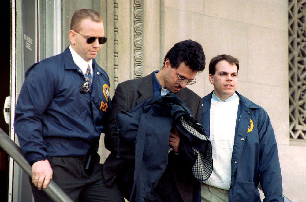 Description of . Nidal A. Ayyad, 25, a chemical engineer arrested in connection with the World Trade Center bombing, is led away by U.S. Marshals at Federal Court after being denied bail on March 12, 1993. (TIMOTHY CLARY/AFP/Getty Images)