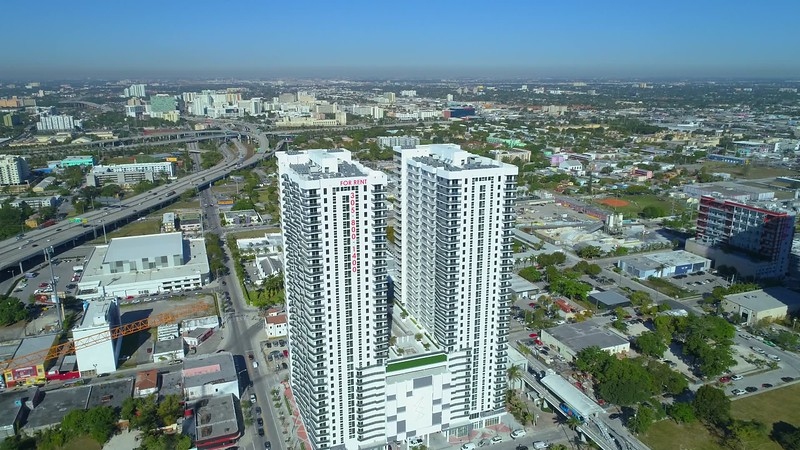 Aerial footage of new construction Downtown Miami residential apartment loft buildings