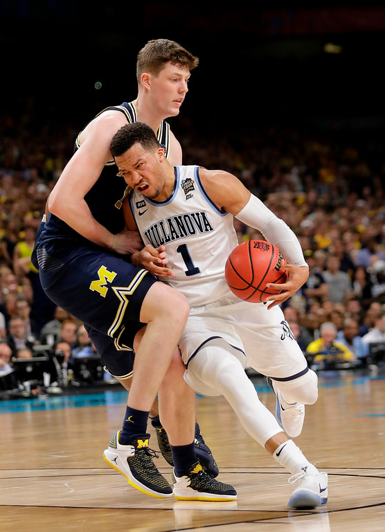 . Villanova\'s Jalen Brunson (1) drives around Michigan\'s Jon Teske during the first half in the championship game of the Final Four NCAA college basketball tournament, Monday, April 2, 2018, in San Antonio. (AP Photo/Eric Gay)