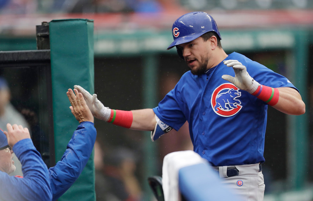 . Chicago Cubs\' Kyle Schwarber is congratulated by teammates after hitting a solo home run off Cleveland Indians starting pitcher Josh Tomlin in the fourth inning of a baseball game, Tuesday, April 24, 2018, in Cleveland. (AP Photo/Tony Dejak)