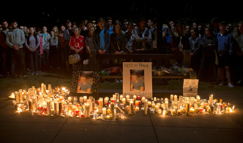 . Mourners stand by during a candlelight vigil for six Irish students Wednesday, June 17, 2015, in Berkeley, Calif. The six Irish students died when a balcony collapsed during a party.  (AP Photo/Beck Diefenbach)