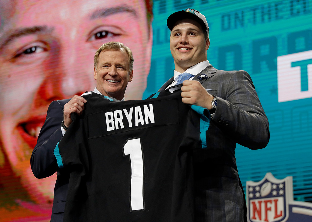 . Commissioner Roger Goodell presents Florida\'s Taven Bryan with his Jacksonville Jaguars team jersey during the first round of the NFL football draft, Thursday, April 26, 2018, in Arlington, Texas. (AP Photo/David J. Phillip)