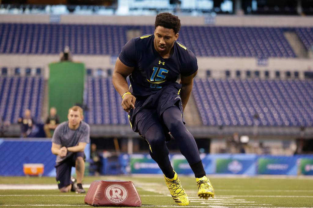 . Texas A&M defensive end Myles Garrett runs a drill at the NFL football scouting combine in Indianapolis, Sunday, March 5, 2017. (AP Photo/Michael Conroy)