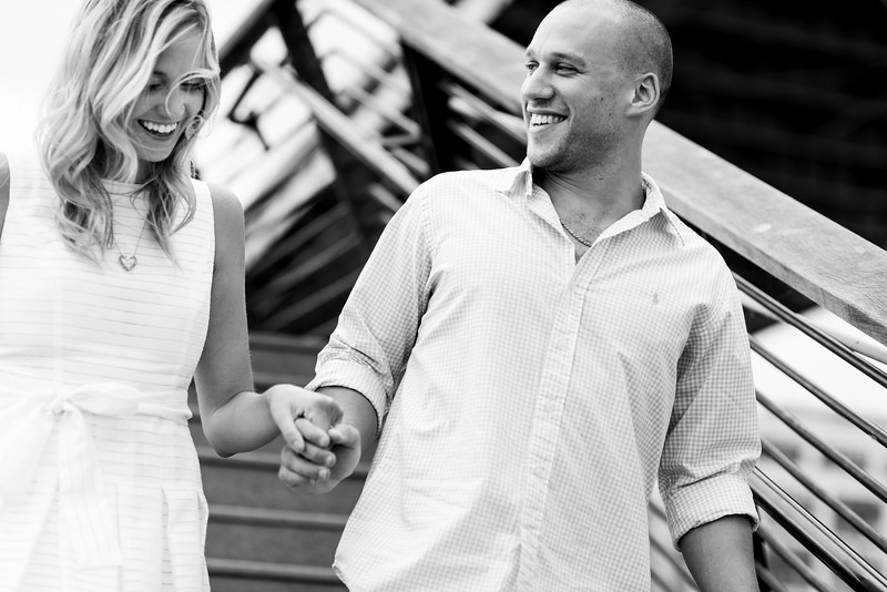 "Devon + Eric // Philadelphia PA // ""Our latest engagement shoot took us to the city of brotherly love, the one and only Philadelphia! We were so thrilled to be able to shoot in a city for an even cooler couple.   Devon and Eric showed Emerald Stone the ropes and introduced us to just a few of their favorite spots, including the scenic walking paths near the Ben Franklin Bridge, some quiet, quaint spots beside the Schuylkill River, and the awesome PHS Pop-Up Garden and Biergarten on South Street.  Even better yet, we got to meet Devon and Eric's 8 month old puppy, Bodhi, who is too adorable for words. We're pretty much totally in love with this couple and their home, and it's not hard to see why."""