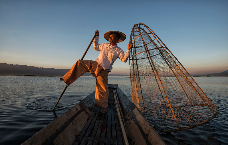 These Burmese fishermen have mastered an unusual technique when it comes to paddling their boats.  Carefully balancing on one leg, wrapping their second leg around the oar to guide the vessel through the freshwater lake.  The skilled technique means the fishermen can stand and look out for reeds in the water and keep both hands free to handle the cumbersome nets.  Inle Lake, Myanmar, 2017