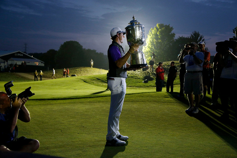 . Rory McIlroy, of Northern Ireland, holds up the Wanamaker Trophy after winning the PGA Championship golf tournament at Valhalla Golf Club on Sunday, Aug. 10, 2014, in Louisville, Ky. (AP Photo/John Locher)