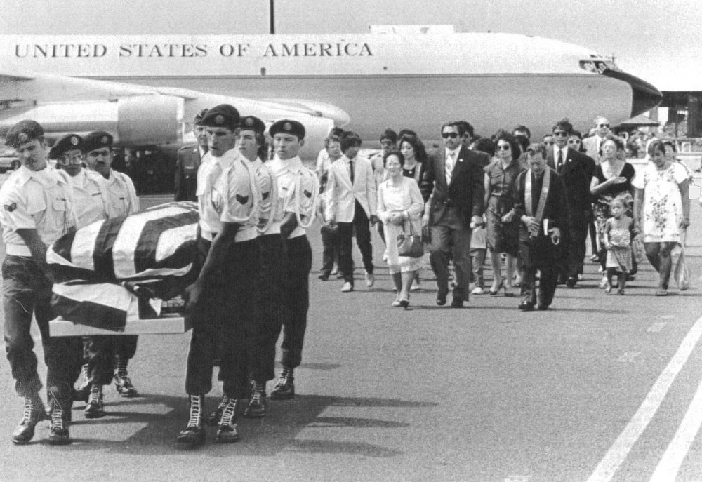 Description of . 5/31/1986, JUN 2 1986  The remains of astronaut Ellison Onizuka , who was killed along with six others in the Jan. 28 explosion of the space shuttle Challenger, were returned to his native island of Hawaii on May 31, 1986. His relatives walk behind the flag-draped casket. Onizuka, an Air Force lieutenant colonel, will be buried Monday at the National Memorial Cemetery of the Pacific in Honolulu on the island of Oahu.  Credit: UPI