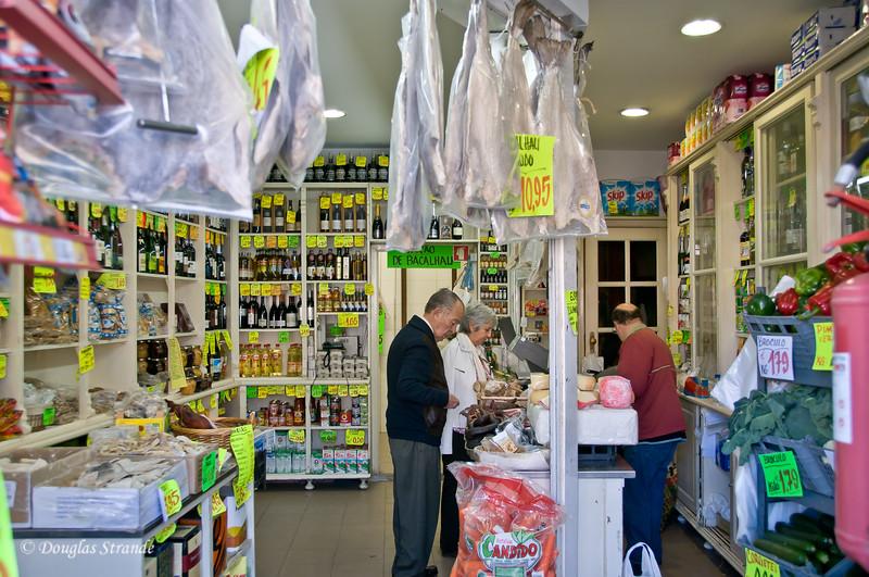 Sat 3/19 in Porto: Casa Oriental (open boxes of dried cod on left)