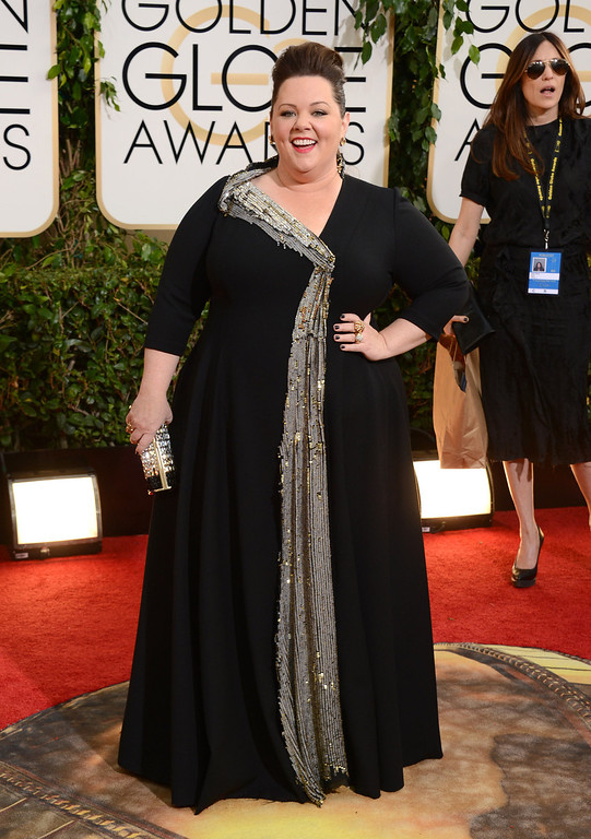 . Melissa McCarthy arrives at the 71st annual Golden Globe Awards at the Beverly Hilton Hotel on Sunday, Jan. 12, 2014, in Beverly Hills, Calif. (Photo by Jordan Strauss/Invision/AP)