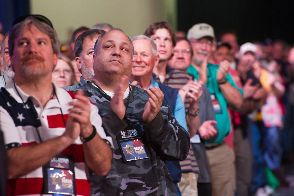 . Attendees applaud a speaker during the leadership forum at the National Rifle Association\'s annual convention Friday, May 3, 2013 in Houston. (AP Photo/Steve Ueckert)