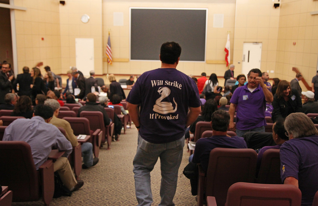 . A union member walks back to his seat as the public hearing before a state panel commissioned by Gov. Jerry Brown takes a break at the Elihu M. Harris State Building in Oakland, Calif., on Wednesday, Aug. 7, 2013. (Laura A. Oda/Bay Area News Group)