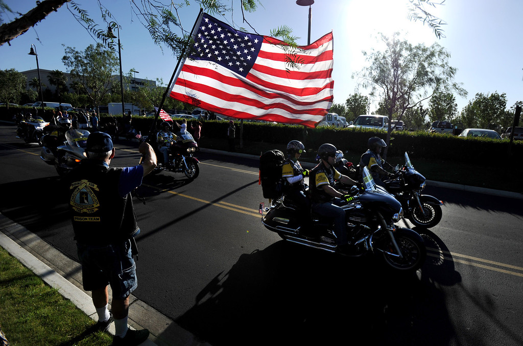 . Navy veteran Jerry Bayless of Westminster, holds the U.S. flag as Run For The Wall (RFTW) riders leave Rancho Cucamonga, Wednesday morning from Victoria Gardens, heading to the Vietnam Memorial Wall in Washington D.C., May 14, 2014. (Photo by John Valenzuela/Inland Valley Daily Bulletin)