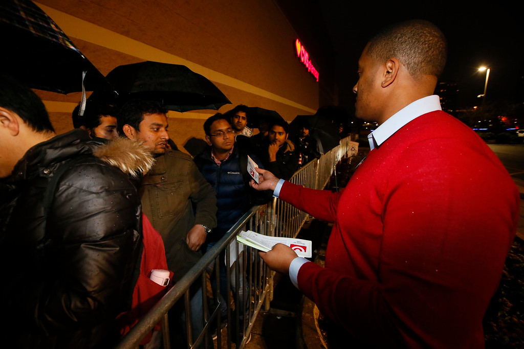 . Target team member hands out doorbuster tickets to eager Black Friday shoppers on Thursday, Nov. 24, 2016, in Jersey City, N.J. (Photo by Noah K. Murray/Invision for Target/AP Images)
