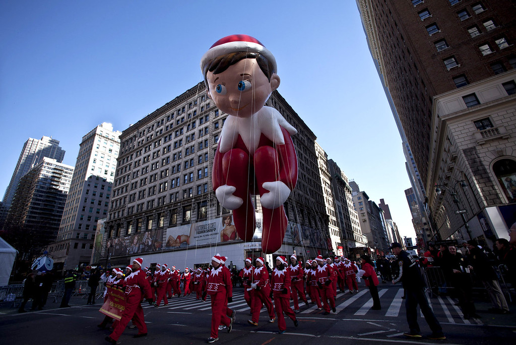 . The Elf on a Shelf balloon floats above the street during the Macy\'s Thanksgiving Day Parade on November 28, 2013 in New York City. Despite earlier concerns about the wind, the balloons flew as planned for the parade. (Photo by Kena Betancur/Getty Images)