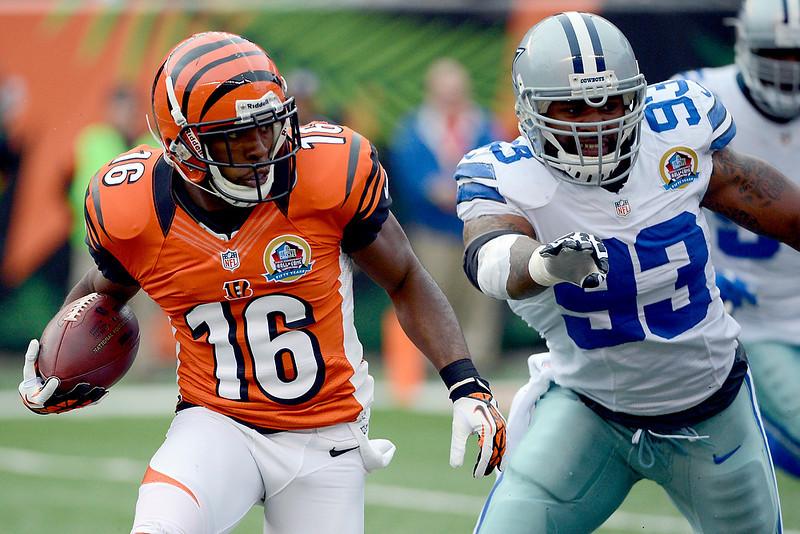 . Cincinnati Bengals wide receiver Andrew Hawkins (16) runs past Dallas Cowboys outside linebacker Anthony Spencer (93) for an 8-yard touchdown after catching a pass in the first half of an NFL football game, Sunday, Dec. 9, 2012, in Cincinnati. (AP Photo/Michael Keating)
