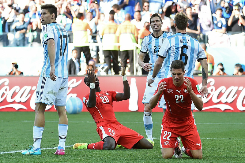 . Switzerland\'s defender Fabian Schaer (2L) and Switzerland\'s defender Johan Djourou (R) react after missing a shot on goal during the final minutes of the second half of extra-time in the Round of 16 football match between Argentina and Switzerland at the Corinthians Arena in Sao Paulo during the 2014 FIFA World Cup on July 1, 2014.  (ANNE-CHRISTINE POUJOULAT/AFP/Getty Images)