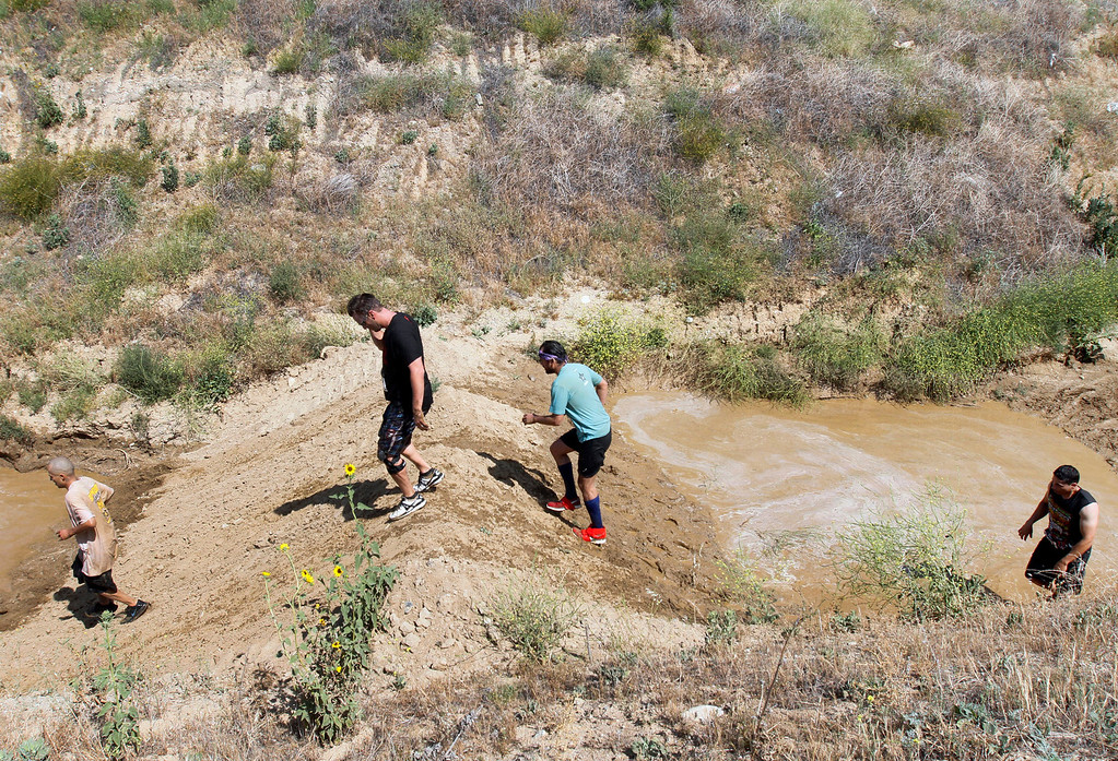 . The Sheriff�s Athletic Federation\'s annual 5K Mud Run takes place on Saturday, May 17, 2014 at the Sheriff�s Department Academy in Devore, Ca. (Photo by Micah Escamilla/Redlands Daily Facts)