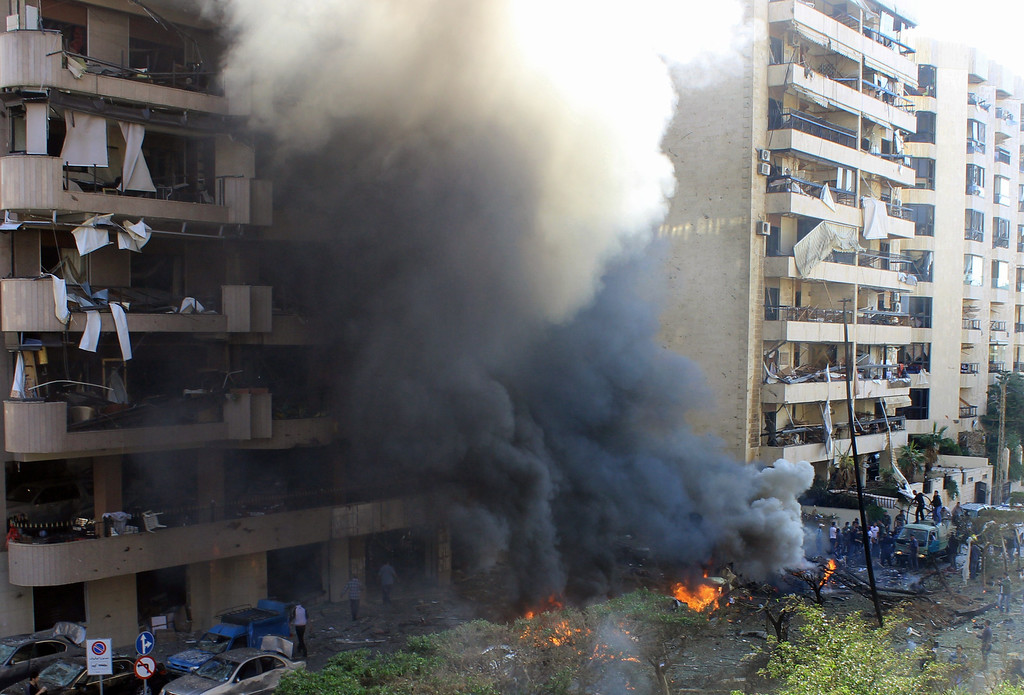 . Flames rise from the site of a blast in Bir Hassan neighborhood in southern Beirut on November 19, 2013. At least 22 people were killed in a double bomb attack outside the Iranian embassy in Beirut, including an Iranian cultural advisor, government sources told AFP. AFP PHOTO/STR-/AFP/Getty Images