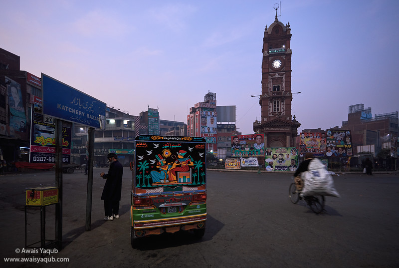 A Rikshaw driver waiting for passenger early in the morning at Clock tower, Faisalabad Pakistan
