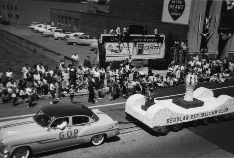 Regular Republican Club parade float on Morris Ave. being pulled by the GOP Mobile in front of the Union Center National Bank.