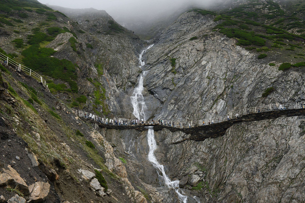 . Hindu devotees walk during their pilgrimage to the holy Amarnath Cave Shrine, at Bairey Marg on  August 18, 2013. Every year, hundreds of thousands of pilgrims trek through treacherous mountains in revolt-torn Kashmir, along icy streams, glacier-fed lakes and frozen passes, to reach the Amarnath cave, located at an altitude of 3,857 meters (12,729 feet), where a Shiva Lingam, an ice stalagmite shaped as a phallus and symbolizing the Hindu God Shiva, stands for worship.  TAUSEEF MUSTAFA/AFP/Getty Images